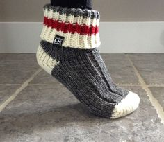 These stylish hand made slipper socks are knit using Briggs and Little wool, from New Brunswick, Canada. They are very cozy and warm and the red stripe is both classic and trendy. Very fashionable knitting!