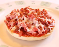 Pizza Bagel Bites... what a perfect lunch! all you need: plain bagels, jar of pizza sauce, bacon bits, cheese, any meat