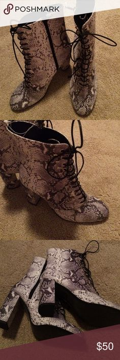 Free People snakeskin boots new sz 37 Snakeskin heeled boots sz 37 new. Tied front silver studs on sides of ties heeled  side zipper by Free People leather made in Spain no box Free People Shoes Ankle Boots & Booties
