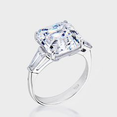 8.0 Ct.  Asscher-Inspired  14K Ring. This gorgeous cubic zirconia ring features a 8.0 carat Asscher-inspired center with a single tapered baguette on each side. An approximate 8.50 total carat weight.This classic high quality cubic zirconia ring is set in solid 14K white gold, and is available in 14K yellow gold via Special Order. Cubic zirconia weights refer to equivalent diamond carat size.