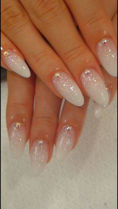 Pretty Nails----- I'd reverse the glitter effect to the tips insead and make it silver.