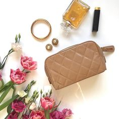 This sought after vintage Chanel beige patent mini pouch can store all your most treasured makeup and jewellery.