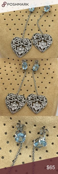Authentic Aquamarine crystal 925 heart earrings Authentic Aquamarine crystal.  Very well made. 925 silver.   Bought in Thailand. Worn once.  Make a reasonable offer and I'll either counter, accept or decline. No trades.  Please check out the rest of my closet, I have various brands. Jewelry Earrings