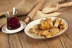Börek, several layers of thin phyllo stuffed with minced meat accompanied by Turkish tea.