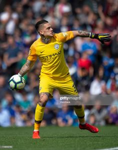 Manchester City goalkeeper Ederson throws the ball out during the Premier League match between Burnley FC and Manchester City at Turf Moor on April 2019 in Burnley, United Kingdom. Manchester City Wallpaper, Burnley Fc, Zen, Golf Stores, Premier League Matches, Goalkeeper, Soccer, Football, Baseball Cards