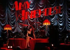 British singer Amy Winehouse sits on stage and looks up at a television monitor whilst awaiting news of her Grammy Award at The Riverside Studios for the 50th Grammy Awards ceremony on February 10, 2008 in London, England.  Winehouse won 5 out of her 6 nominations including, record of the year, best new artist, song of the year, pop vocal album and female pop vocal performance.