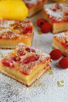 Luscious Raspberry Lemon Bars - Sweet, tangy and decadent recipe! The crisp crust delivers a delicious tangy raspberry lemon custard that is sure to stick to your fingers. | jessicagavin.com