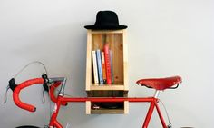 This sustainable wood bike rack designed to keep you organized while showcasing your bike as a centerpiece.