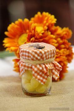 cheap decor/party favors...lemon drops and orange slices in mason jars.