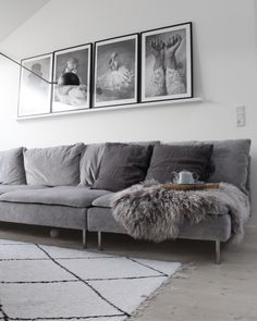 Cool Scandinavian inspired living room with a grey velvet sofa | black and white photo art | beni ourain style rug | IKEA Söderhamn sofa with a Bemz cover in Zinc Grey Zaragoza Vintage Velvet