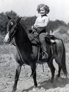 Shirley Temple on horseback, 1930s.