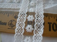 Ivory White flowers embroidered on net lace trim  Choose 1, 2, 3 or 4 yard lots,  Please see pictures. about 1.25 wide.  Gorgeous edging insert to sew on a garment.  If you order multiple lots, I will do my best to send one piece.  More lace and trims can be found in this section of my shop: https://www.etsy.com/shop/kabooco?section_id=8060145  Item ships via first class mail within 2 days of payment. I ship mainly to USA but if you live somewhere else, please send me a convo and Ill see…