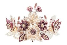 An utterly luxurious and one-off statement bridal hair accessory, as divine as the mythical Helene. Combining exquisite guipure lace elements, handmade silk Kanzashi flowers and genuine Swarovski crystals and pearls, this elaborate bridal hair adornment is all about the small details. Each and every little petal is hand-crafted, folded and assembled, and numerous Swarovski crystals and pearls are hand-appliqued to create this complex composition. The high quality metal base of the crown is…