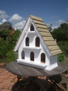 wall mounted dovecote - externally finished with knotting, primer, two undercoats and two coats of white gloss