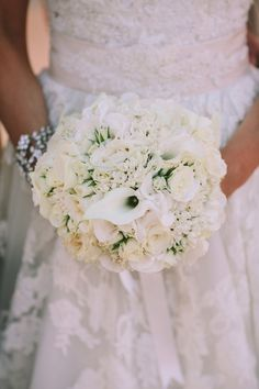 Whimsical white bouquet: http://www.stylemepretty.com/destination-weddings/2015/03/02/romantic-destination-wedding-in-santorini/   Photography: George Pahountis - www.wedshooter.gr