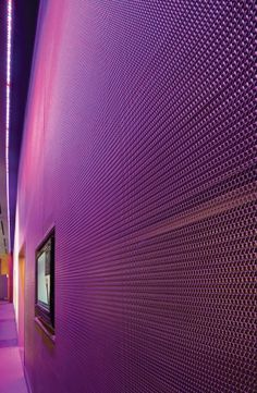 Visitors to the W Hoboken Hotel lobby are greeted by a glowing metal mesh wall.