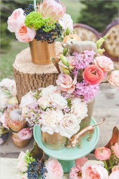tin can floral centerpieces #goldweddingideas  #eclecticwedding #weddingchicks http://www.weddingchicks.com/2013/12/23/elcectic-gold-wedding-ideas/