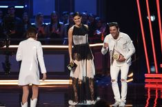 Zac Efron and Alexandra Daddario Photos Photos - (L-R) Actor Millie Bobby Brown accepts the award for Best Actor in a Show from actors Alexandra Daddario and Zac Efron onstage during the 2017 MTV Movie And TV Awards at The Shrine Auditorium on May 7, 2017 in Los Angeles, California. - 2017 MTV Movie And TV Awards - Show