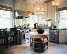 Traditional Kitchen: A travertine-topped circular island in a kitchen.