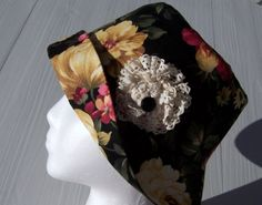 Downton Abbey Cloche Hat Women's Chemo Hat Black Floral with Flannel lining Lace flower accent donation made to Cancer Society. $22.00, via Etsy.