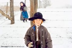 2048 seth and his sister a red headed amish boy stand in the snow with his sister hiding in the background - http://www.amishphoto.com/images/image_pages/2048.htm