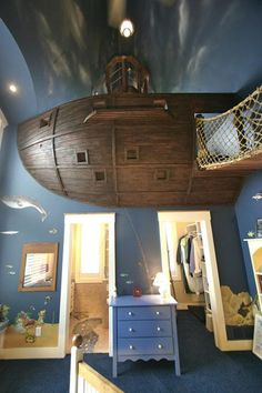 Yes. That is a pirate ship mounted to the wall/ceiling. And yes, you can walk up that rope bridge into the ship!