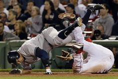 New York Yankees' Alex Rodriguez, left, crashes into Boston Red Sox first baseman James Loney as he reaches on an error on his grounder during the ninth inning of a baseball game at Fenway Park in Boston Wednesday, Sept. 12, 2012.