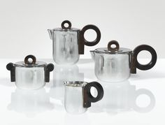 Jean E. Puiforcat 1897 - 1945 SERVICE À THÉ ET À CAFÉ, VERS 1935 A SILVER AND ROSEWOOD FOUR PIECE TEA AND COFFEE SET BY JEAN E. PUIFORCAT, CIRCA 1935. EACH PIECE WITH MAKER'S AND SILVER GUARANTEE MARKS