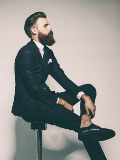 Beard and suit.