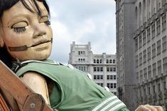 Giant puppet having a nap. By Royal de Luxe