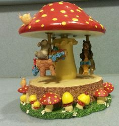 """Charming Tails """"Mushroom Carousel"""" by Dean Griff - http://collectiblefigurines.net/charming-tails/charming-tails-mushroom-carousel-by-dean-griff/"""