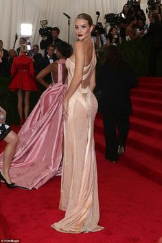 If you've got it...: The British beauty revealed her gym-honed figure in the form-fitting frock, which clung to her physique and dazzled with a shimmering texture and swathes of satin across the bodice and skirt