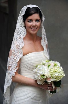 Mantilla veil, plus her bouquet is gorgeous! Maybe wrapped in red or some kind of accent of red.