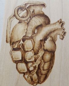 finished up my little keychain. Im going to #scrollsaw it out and give it away at #twitchcon #woodburning #woodworking #pyrography #art #grenade #heart