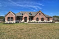 David Weekley Homes - Fredericksburg floor plan - 3280 SF 1-story, w/ side entry garage.  Exterior is combination stone and brick...