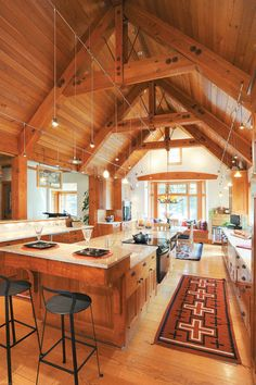 The elaborate wood ceilings in this home help to establish the Western lodge-inspired look in the interior. Heart Pine Flooring, Pine Floors, Garden Design Images, Oakwood Homes, Wide Plank Flooring, Interior Windows, Home Trends, Cabin Homes, Inspired Homes