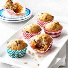 Favorite Banana Chip Muffins Recipe -These muffins are one of the first things my husband gets hungry for when he's home from deployment. I make sure to have the overripe bananas ready. They're a family tradition. —Kimberly Duda, Sanford, North Carolina