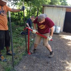 BB&T employees pulling out the old T-posts, as they built a new goat paddock at our Teaching Farm.  #FoodShuttleGrows #Thankyou #Volunteers #TryonRoadTeachingFarm