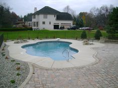 In-ground pool with concrete surround