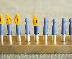 "Even little ones can ""light"" this flameless menorah made from colored clothespins. Get instructions from our pals @FamilyFun magazine: http://www.parents.com/fun/arts-crafts/kid/holiday-crafts-for-kids/?socsrc=pmmpin112812wwfClothespinMenorah#page=2"