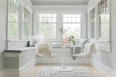 The neutral color palette of this sunroom keeps it welcoming and airy. The Docksta Table ($199) fits perfectly into this small space. Photo by Melissa Oholendt via Emily Henderson