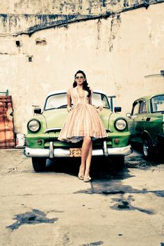 I like the color of this picture and the old car and the dress!