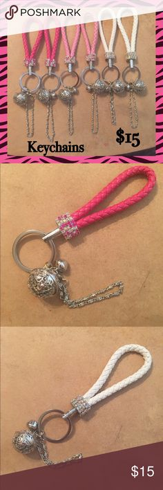 Keychain W/ Crystals, Bell & Chain. I'm not sure if the braided area is leather or not. These are really cute with a lot of decoration on it!!!  These will sell very quickly, so buy yours now!!!  FOR $8 MORE ADD A POM POM FLUFF TO YOUR KEYCHAIN!!! Accessories Key & Card Holders