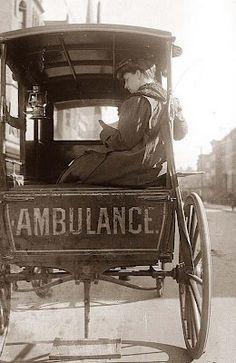 Dr. Elizabeth Bruyn (surgeon) of Brooklyn sitting in the back of a horse-drawn ambulance.