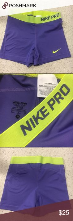 Nike Pro shorts Purple and lime Nike pro spandex shorts. Never worn, but has a small black mark on front. Nike Shorts