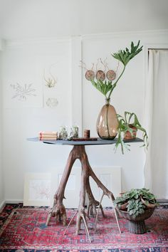 A branch plus a piece of slate creates a truly one-of-a-kind DIY table.