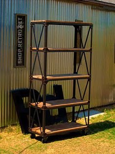 vintage industrial bookcase If you like this then check out my shop for one of a kind handmade art and decor items https://www.etsy.com/shop/SalehDesigns?ref=si_shop industrial chic vintage reclaimed up cycled repurposed game of thrones gears steampunk welded steel sculptures eclectic decor