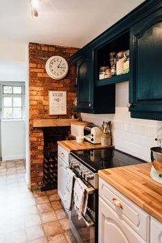 Hague Blue Painted Cupboards And Exposed Brick Wall - Elle's Modern Country Kitchen Makeover