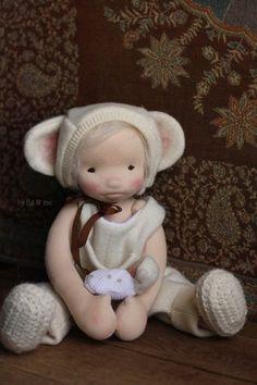 Raisa, a natural cloth art doll ready to play.