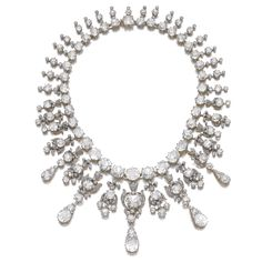 IMPORTANT DIAMOND NECKLACE, CIRCA 1900 Composed of a rivière of variously cut diamonds including cushion-shaped, circular-cut and rose diamonds, suspending a fringe of similarly set foliate and drop motifs, length approximately 375mm.